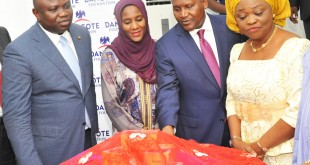 L-R: Executive Lagos State Governor, Mr. Akinwunmi Ambode; Executive Director, Dangote Group, Halima Aliko Dangote; President/CE, Dangote Group, Aliko Dangote; Lagos State Commissioner for Women Affairs and Poverty Alleviation, Mrs. Lola Akande; during The Official flag-off of the Dangote Foundation Micro Grant Scheme for Women in LGAS/LCDAS on Thursday, 26th May, 2016 in Lagos.