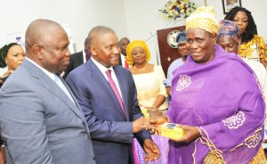 L-R: Executive Lagos State Governor, Mr. Akinwunmi Ambode; President/CE, Dangote Group, Aliko Dangote; Lagos State Commissioner for Women Affairs and Poverty Alleviation, presenting the grant to Mrs. Lola Akande; a beneficiary, Mrs. Idowu Alenimadehin from Epe; during The Official flag-off of the Dangote Foundation Micro Grant Scheme for Women in LGAS/LCDAS on Thursday, 26th May, 2016 in Lagos.