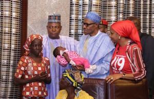 President-Buhari-carrying-baby-Safiyat