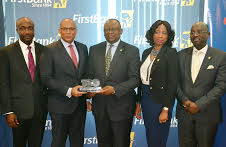 L- R: Mr. Charles Ifedi, Divisional CEO, Consumer Segments, Interswitch Limited; Mr. Mitchell Elegbe, GMD/CEO, Interswitch Limited; Dr. Adesola Adeduntan, MD/CEO, First Bank of Nigeria Limited and Subsidiaries; Mrs. Folashade Femi-Lawal, Head, Digital Banking, First Bank of Nigeria Limited; and Mr. Seyi Oyefeso; Group Executive, Commercial Banking, First Bank of Nigeria Limited at the official recognition of FirstBank's 100 million monthly transactions milestone at FirstBank Headquarters in Lagos