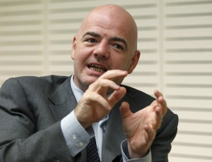 Gianni Infantino gestures during an interview with Reuters at the UEFA headquarters in Nyon, Switzerland, in this July 5, 2011 file photo. World soccer body FIFA on Wednesday named the seven confirmed candidates vying for the FIFA presidency at a February 26 election. In a statement, Zurich-based FIFA said the candidates proposed were: Prince Ali Bin Al Hussein, Musa Hassan Bility, Jerome Champagne, Gianni Infantino, Michel Platini, Sheikh Salman bin Ebrahim Al Khalifa and Tokyo Sexwale. REUTERS/Ruben Sprich/Files